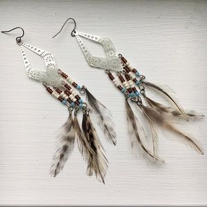 Metal and feather dangle earrings